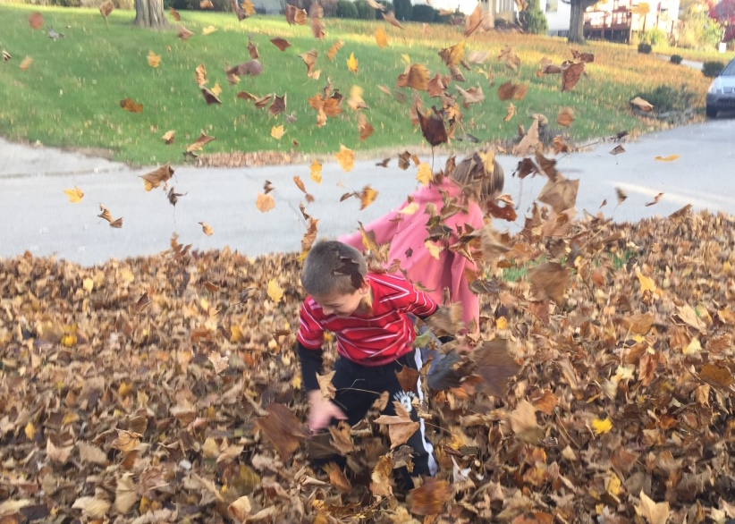 Anthony and Lanny Jumping in Leaves Close UP